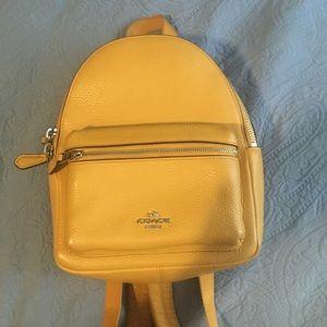 Coach MiniCharlie Pebble Mustard Backpack